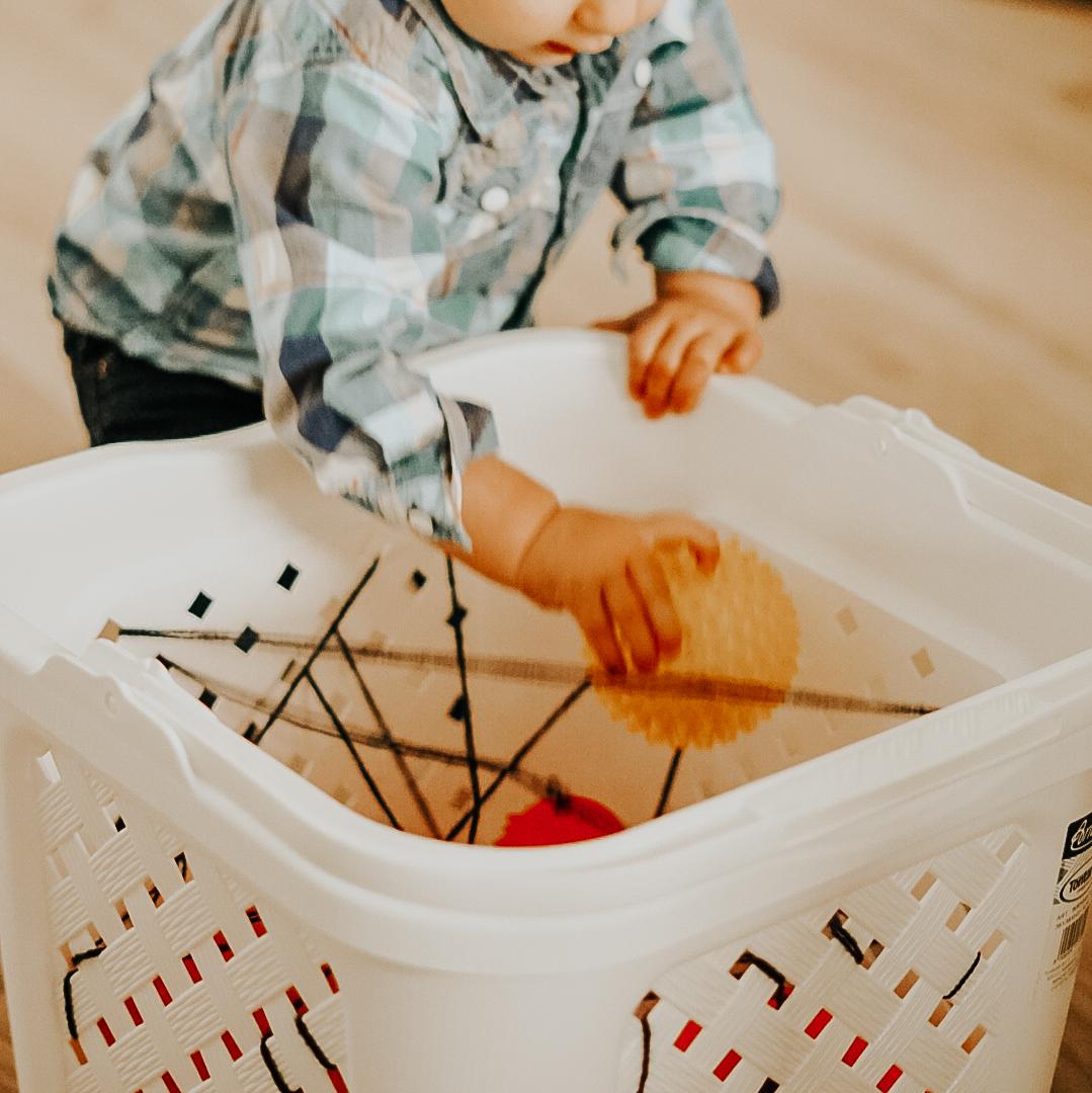 Speeltip spinnenweb voor baby